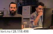 Купить «creative team with computer working late at office», видеоролик № 28118498, снято 29 января 2018 г. (c) Syda Productions / Фотобанк Лори