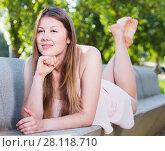 Купить «Woman is lying on bench in her free time», фото № 28118710, снято 10 июня 2017 г. (c) Яков Филимонов / Фотобанк Лори