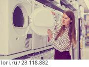 Купить «Modern female housewife choosing new washer», фото № 28118882, снято 12 декабря 2017 г. (c) Яков Филимонов / Фотобанк Лори
