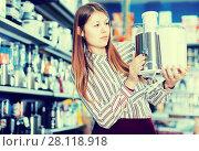 Купить «Positive girl looking for multitask food processor in store of kitchen appliances», фото № 28118918, снято 12 декабря 2017 г. (c) Яков Филимонов / Фотобанк Лори