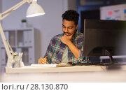 Купить «creative man with notebook working at night office», фото № 28130870, снято 24 января 2018 г. (c) Syda Productions / Фотобанк Лори
