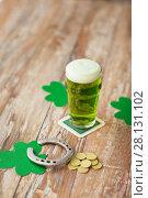 Купить «glass of green beer, horseshoe and gold coins», фото № 28131102, снято 31 января 2018 г. (c) Syda Productions / Фотобанк Лори