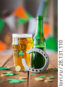Купить «glass of green beer, horseshoe and gold coins», фото № 28131110, снято 31 января 2018 г. (c) Syda Productions / Фотобанк Лори
