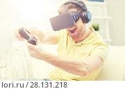 Купить «man in virtual reality headset with controller», фото № 28131218, снято 12 марта 2016 г. (c) Syda Productions / Фотобанк Лори