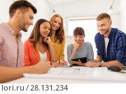 Купить «creative team with blueprint working at office», фото № 28131234, снято 27 февраля 2016 г. (c) Syda Productions / Фотобанк Лори