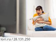 Купить «stunned asian woman with watching tv at home», фото № 28131250, снято 9 марта 2016 г. (c) Syda Productions / Фотобанк Лори