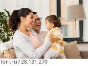 Купить «happy family with baby daughter at home», фото № 28131270, снято 11 ноября 2017 г. (c) Syda Productions / Фотобанк Лори