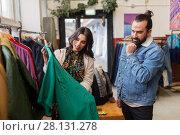 Купить «couple choosing clothes at vintage clothing store», фото № 28131278, снято 30 ноября 2017 г. (c) Syda Productions / Фотобанк Лори