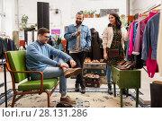 Купить «friends choosing clothes at vintage clothing store», фото № 28131286, снято 30 ноября 2017 г. (c) Syda Productions / Фотобанк Лори