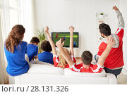 Купить «football fans watching soccer game on tv at home», фото № 28131326, снято 14 августа 2016 г. (c) Syda Productions / Фотобанк Лори
