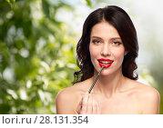 Купить «beautiful woman with make up brush for lipstick», фото № 28131354, снято 5 января 2018 г. (c) Syda Productions / Фотобанк Лори