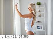 Купить «woman taking selfie by smartphone in morning», фото № 28131386, снято 20 апреля 2017 г. (c) Syda Productions / Фотобанк Лори