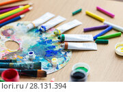 Купить «acrylic color or paint tubes and palette», фото № 28131394, снято 1 июня 2017 г. (c) Syda Productions / Фотобанк Лори