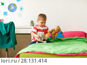 Купить «happy little boy playing with plush toys at home», фото № 28131414, снято 15 октября 2017 г. (c) Syda Productions / Фотобанк Лори