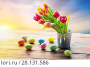Купить «close up of easter eggs and flowers in bucket», фото № 28131586, снято 28 января 2016 г. (c) Syda Productions / Фотобанк Лори