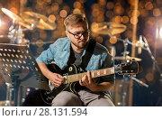 Купить «man playing guitar at studio rehearsal», фото № 28131594, снято 18 августа 2016 г. (c) Syda Productions / Фотобанк Лори