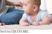 Купить «sweet little asian baby boy with mother», видеоролик № 28131682, снято 24 февраля 2018 г. (c) Syda Productions / Фотобанк Лори