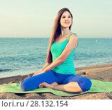 Купить «Young woman in blue T-shirt is sitting and practicing asana», фото № 28132154, снято 4 августа 2017 г. (c) Яков Филимонов / Фотобанк Лори