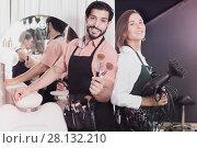 Купить «Smiling woman hairdresser and male makeup artist», фото № 28132210, снято 23 сентября 2018 г. (c) Яков Филимонов / Фотобанк Лори