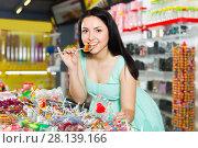 sexy active female posing in the store with lolly. Стоковое фото, фотограф Яков Филимонов / Фотобанк Лори