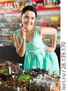 pleased sexy female posing in the store with lolly. Стоковое фото, фотограф Яков Филимонов / Фотобанк Лори