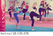Купить «women are boxing and doing kick with coach», фото № 28139378, снято 8 октября 2017 г. (c) Яков Филимонов / Фотобанк Лори