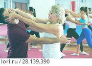 Купить «Woman is training self-defence fighter in pair with trainer», фото № 28139390, снято 8 октября 2017 г. (c) Яков Филимонов / Фотобанк Лори