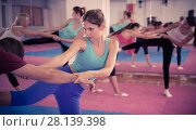 Купить «Young woman practicing box fighter with coach», фото № 28139398, снято 8 октября 2017 г. (c) Яков Филимонов / Фотобанк Лори