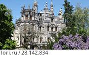 Купить «SINTRA - APRIL 07: Quinta da Regaleira palace located in the municipality of Sintra, about 25km northwest of Lisbon. April 07, 2017 in Sintra, Portugal», видеоролик № 28142834, снято 7 апреля 2017 г. (c) Алексей Кузнецов / Фотобанк Лори