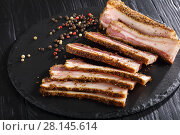 sliced spicy smoked speck, top view. Стоковое фото, фотограф Oksana Zh / Фотобанк Лори
