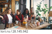 Купить «Four beautiful young woman doing selfie in a cafe, best friends girls together having fun», видеоролик № 28145942, снято 30 января 2018 г. (c) Виктор Аллин / Фотобанк Лори