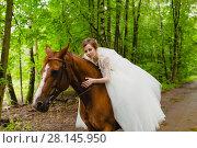 Купить «Beautiful young bride with the horse», фото № 28145950, снято 22 июля 2017 г. (c) Чебеляев Геннадий / Фотобанк Лори