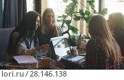 Купить «Beautiful businesswoman discussing documents in a cafe over a Cup of coffee», видеоролик № 28146138, снято 30 января 2018 г. (c) Виктор Аллин / Фотобанк Лори