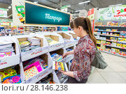 Купить «Woman choosing office supplies at shopping in superstore Karusel», фото № 28146238, снято 3 сентября 2017 г. (c) FotograFF / Фотобанк Лори