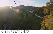 Купить «Unique SKYPARK AJ Hackett Sochi, Ahshtyrskaya gorge in the Mzymta river valley», видеоролик № 28146470, снято 3 ноября 2017 г. (c) Ирина Мойсеева / Фотобанк Лори