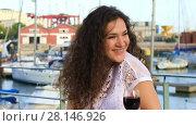 Купить «Lovely young woman drinking red wine sitting in a cafe outdoors with a great views of the bay with yachts», видеоролик № 28146926, снято 4 июня 2017 г. (c) Алексей Кузнецов / Фотобанк Лори