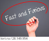 Купить «Man Hand writing Fast and Furious with black marker on visual screen», фото № 28149954, снято 13 декабря 2018 г. (c) easy Fotostock / Фотобанк Лори