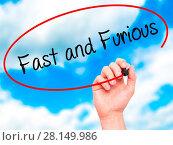 Купить «Man Hand writing Fast and Furious with black marker on visual screen», фото № 28149986, снято 13 декабря 2018 г. (c) easy Fotostock / Фотобанк Лори