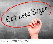 Купить «Man Hand writing Eat Less Sugar with black marker on visual screen», фото № 28150754, снято 22 ноября 2018 г. (c) easy Fotostock / Фотобанк Лори