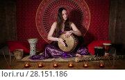 Купить «Young Caucasian woman playing drum, ethnic musical instrument», видеоролик № 28151186, снято 20 апреля 2016 г. (c) Алексей Кузнецов / Фотобанк Лори