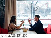 Купить «Smiling couple having dinner and drinking white wine at date in restaurant», фото № 28151250, снято 7 февраля 2018 г. (c) Виктор Аллин / Фотобанк Лори