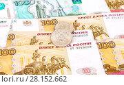 Купить «Russian rubles coins lying over different currency banknotes close up», фото № 28152662, снято 29 октября 2017 г. (c) FotograFF / Фотобанк Лори