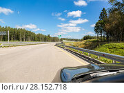 Купить «Toll road. Russian highway number M11 in summer day», фото № 28152718, снято 8 августа 2017 г. (c) FotograFF / Фотобанк Лори