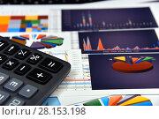 Купить «Калькулятор, графики и диаграммы. Бизнес-натюрморт», эксклюзивное фото № 28153198, снято 11 марта 2018 г. (c) Юрий Морозов / Фотобанк Лори