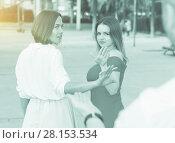 Купить «Young females are rejecting stranger man», фото № 28153534, снято 18 октября 2017 г. (c) Яков Филимонов / Фотобанк Лори