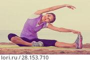 Купить «Woman practising yoga poses sitting on beach by sea», фото № 28153710, снято 20 февраля 2019 г. (c) Яков Филимонов / Фотобанк Лори