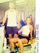 Купить «man and woman fitness coaches in gym», фото № 28153902, снято 4 октября 2016 г. (c) Яков Филимонов / Фотобанк Лори