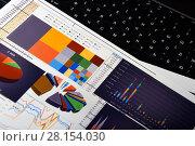 Купить «Калькулятор, графики, диаграммы и таблицы. Бизнес-натюрморт», эксклюзивное фото № 28154030, снято 11 марта 2018 г. (c) Юрий Морозов / Фотобанк Лори