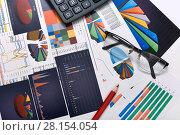 Купить «Калькулятор, таблицы, графики и диаграммы. Бизнес-натюрморт», эксклюзивное фото № 28154054, снято 11 марта 2018 г. (c) Юрий Морозов / Фотобанк Лори