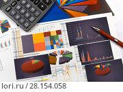 Купить «Калькулятор, таблицы, графики и диаграммы. Бизнес-натюрморт», эксклюзивное фото № 28154058, снято 11 марта 2018 г. (c) Юрий Морозов / Фотобанк Лори
